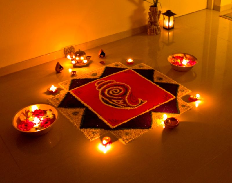 Rangoli Kolam Design with Rose Petals and Candles